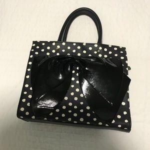 Black and white polka dot purse.